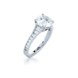 Round Diamond and Platinum Ring with a Step Cut Diamond Band