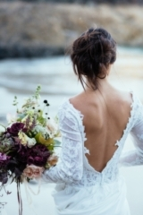 Pared back 'beach bride' elegance at Kynance Cove in Cornwall, with dresses by Maria Senvo. Styled a
