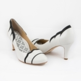 "3"" scalloped toe and heel pump. Available in Robins Egg/White, Buttercream/Black"