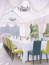 white tent with chandeliers