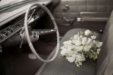 wedding bouquet in a retro car