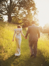 bride groom walking away holding hands afternoon light