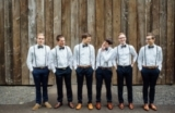 groomsmen with bowties and suspenders