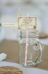 pink flowers in blue mason jars, milk glass, burlap table runners, mason jars with handles, pink str