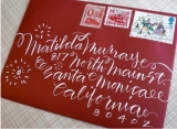 red wedding invitation envelope
