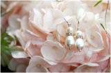 light pink hydrangeas pretty pearl drop and diamond earrings bridal accessories pink and white South