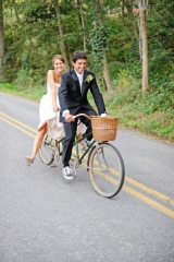 Bride in flip flops on bicycle with basket
