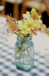 rustic backyard rehearsal dinner, blue and white table linen, mason jar center piece, wildflower cen