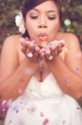 bride blowing confetti shoes wedding dress