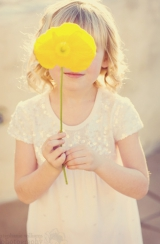 Little Girl with Yellow Flower