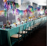 colorful reception with long table and streamers
