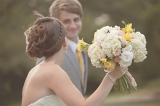 yellow and white wedding flowers, bride with braided updo