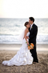 White and orange bridal bouquet bride and groom on beach, private estate wedding, pacific palisades