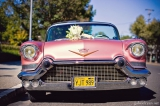 Bridal bouquet on pink classic car