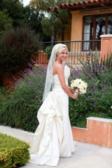 Bride poses in front of lavender flowers