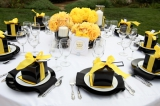 Yellow and black reception tables