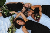 Bridesmaids with boquets on picnic blanket