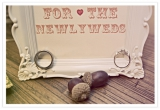 newlyweds frame with rings, acorns, white frame, rustic