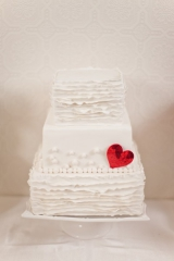 white ruffly wedding cake