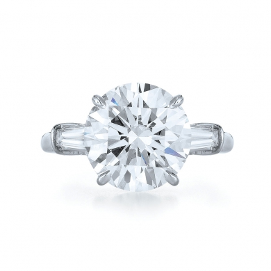 Round Diamond and Platinum Ring with Two Tapered Baguettes