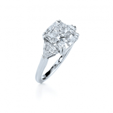 Radiant Cut Diamond and Platinum Ring with Two Trilliants
