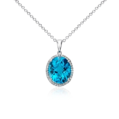 Swiss Blue Topaz and White Sapphire Halo Oval Pendant in Sterling Silver