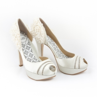 "Keyhole peeptoe with illusion mesh slits and flutter petal 5"" heels. Available in Buttercream, Ice B"